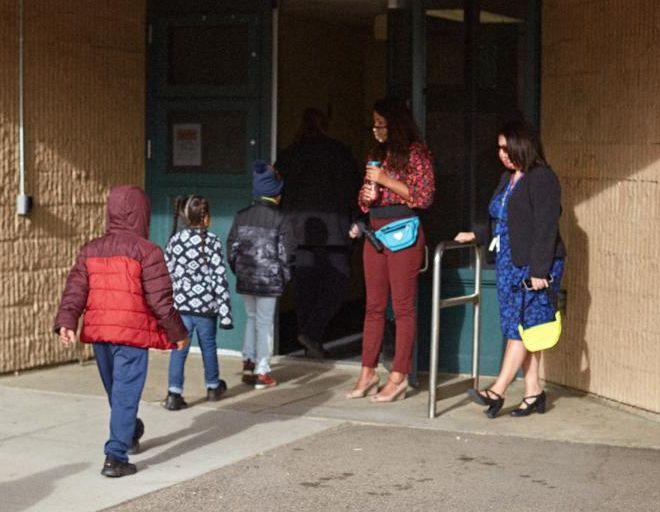 Welcoming back students at John H. Amesse. Photo credit: Roy Barnett Jr