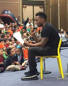 Brandon Marshall read to students at Cheltenham Elementary.