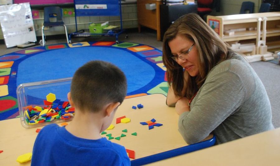 Brandy Barhite works with a preschool student at Beach Court Elementary