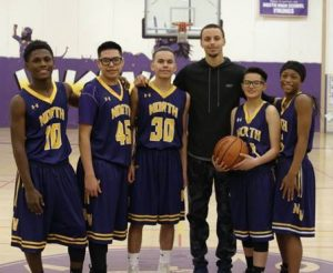 Basketball star Steph Curry poses with students at North High School.