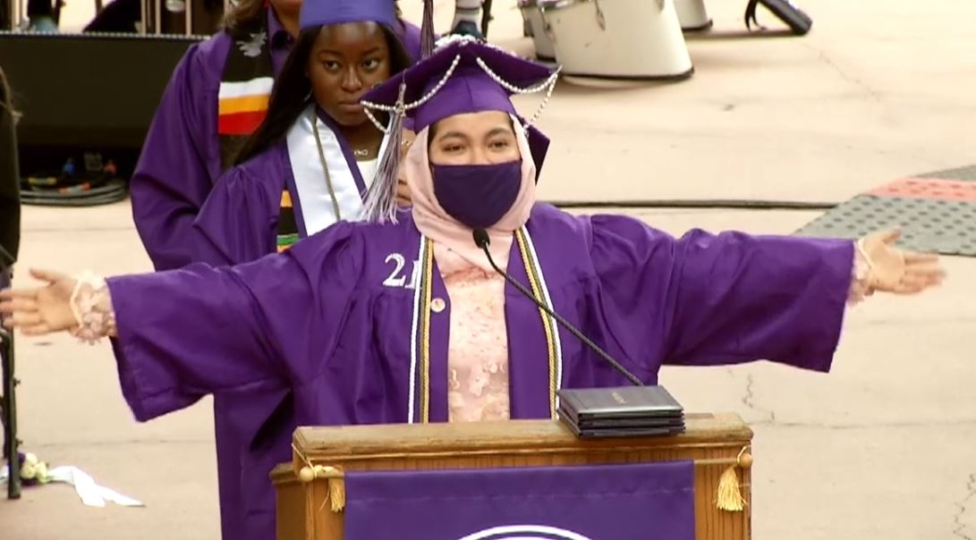 Student in a graduation cap and gown