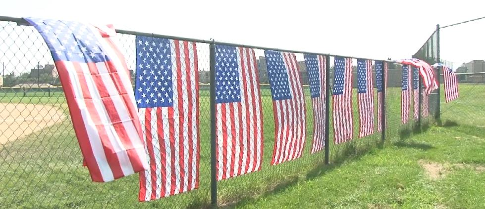 American flags hanging on a fence