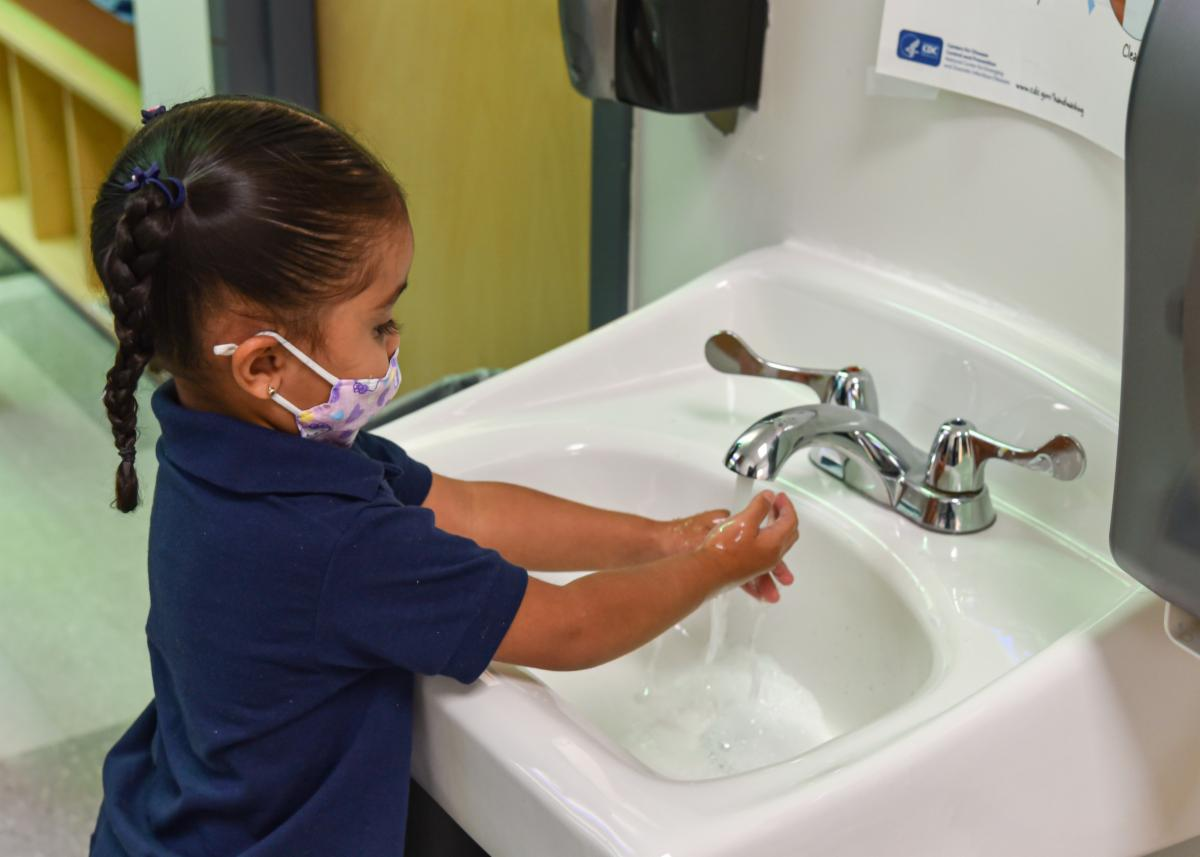 Student washing her hands
