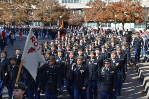 Students marching toward the camera during the 2019 Veterans Day Parade