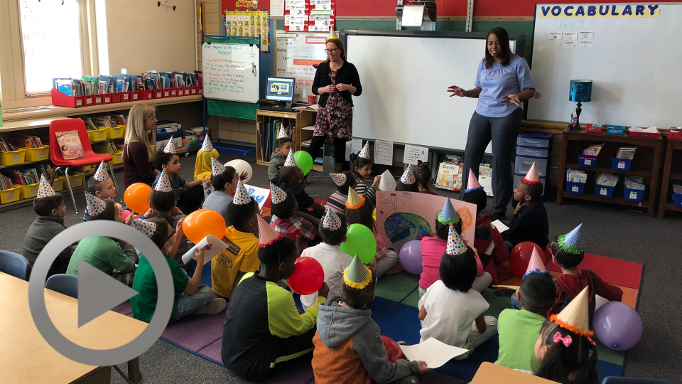 """Sarah Luckey, the first """"graduate"""" of the Paraprofessional-to-Teacher training program, and Fairview principal Antoinette Hudson talk with students before the celebration."""