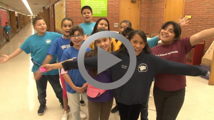 Excited children in a hallway at school