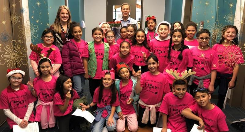 Superintendent Tom Boasberg and fourth-grade students from Traylor Academy in Southwest Denver surprised team members at the Emily Griffith Campus with caroling and candy canes.