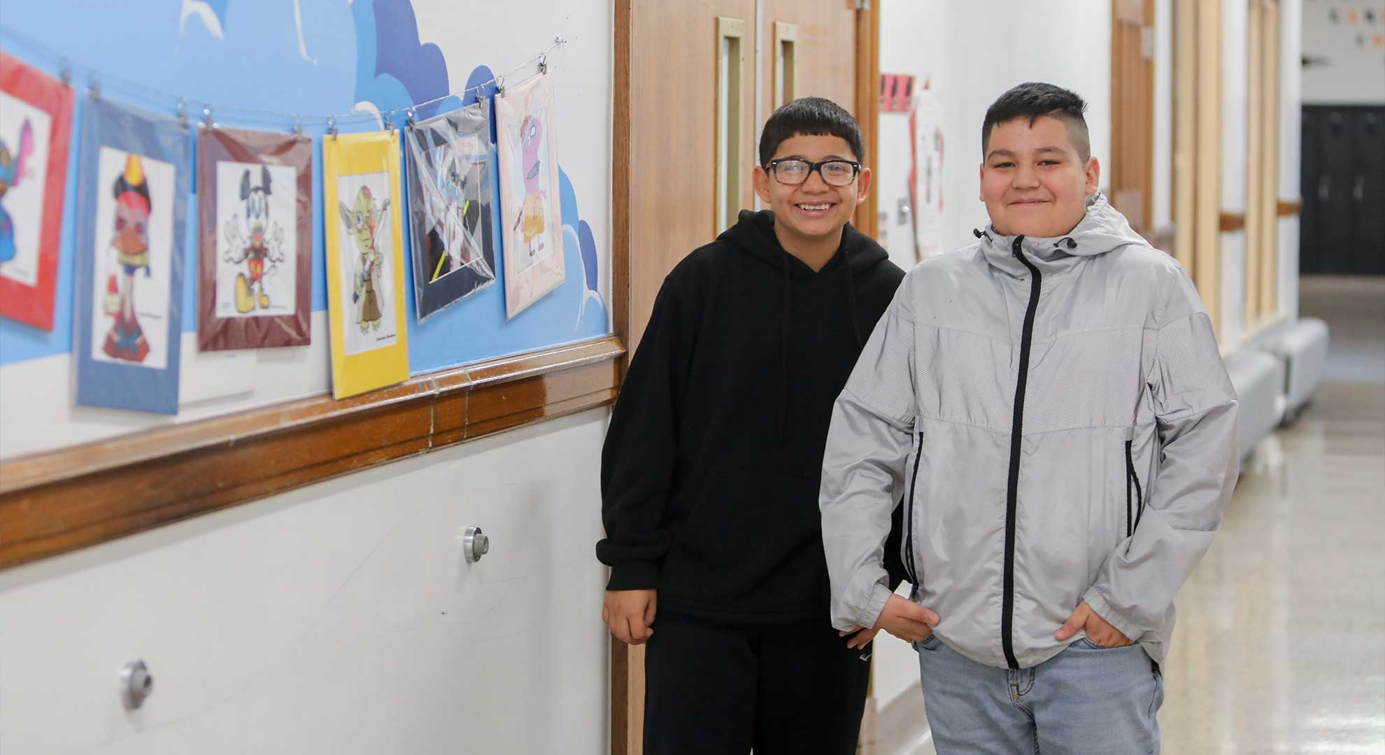 Two students in the hallway